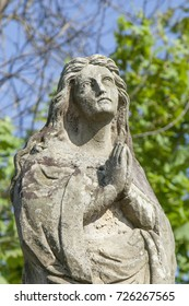 Fragment of ancient statue of Mary Magdalene  in prayer (Prayer, faith, religion, love, hope concept)