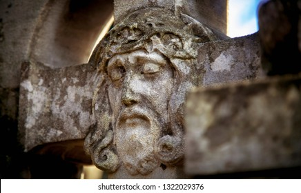 Fragment of antique statue Jesus Christ of Nazareth as a symbol of death, resurection,  love, faith and religion.