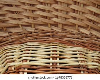 a fragment of a basket woven from willow twigs is captured on camera in close up