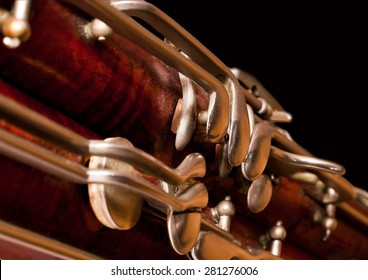 Fragment of the bassoon on a black background