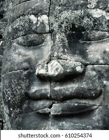Fragment of the Bayon temple with smiling Buddha close up in the complex of Angkor Thom, Siem Reap, Cambodia,
