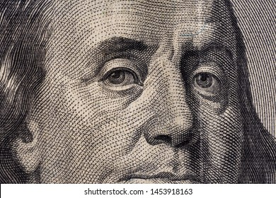 A fragment of a bill of 100 US dollars.Portrait of Benjamin Franklin