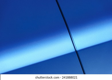 Fragment of blue steel car body. Vehicle paint coating texture. Abstract.