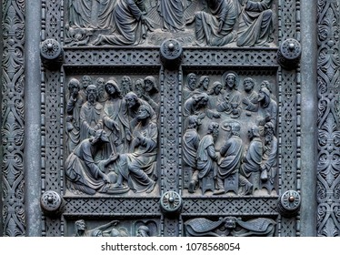 Fragment of Bremen's Cathedral Metalic Door with decorations depicting Jesus washing the feet of the disciples and Last supper, Germany. Reliefs were designed by Peter Fuchs in 1891.