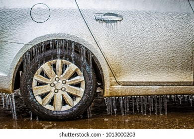 fragment of car covered with ice