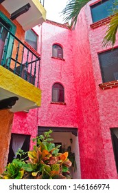 Fragment of the caribbean mexican building in traditional style. Colorful brightly colored walls.