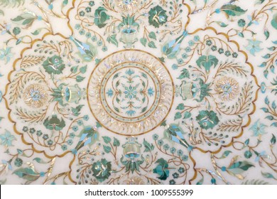 Fragment carved marble panels with floral patterns of enamel, gold and nacre