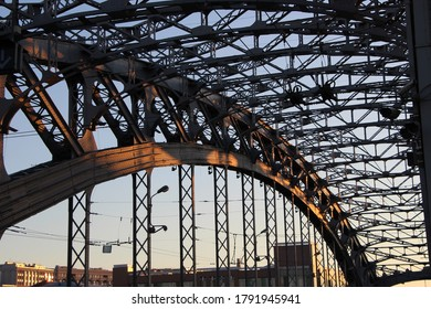 Fragment of the ceilings of the bridge span in the setting sun. (Peter the Great Bridge. Years of construction 1908-1911)