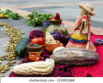 Fragment of Chacana or Ceremony in homage to Pachamama (Mother Earth) is an aboriginal ritual of indigenous peoples of Andes. Different food: beans, corn, tomatoes, cocoa beans on the scarf. Ecuador