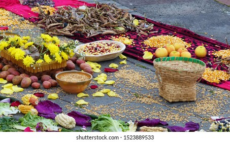 Fragment of Chacana or Ceremony in homage to Pachamama (Mother Earth) is an aboriginal ritual of the indigenous peoples of Ecuador. Beans, corns, apples, nuts, seeds, salad and flowers on the scarf
