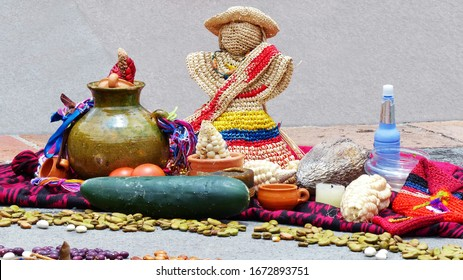 Fragment of Chacana or Ceremony in homage to Pachamama (Mother Earth) is an aboriginal ritual of indigenous peoples of Andes. Different food: beans, corn, tomatoes, cocoa beans, straw doll. Ecuador