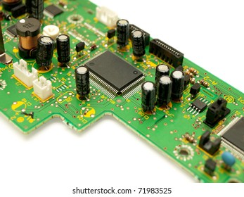 Fragment of a circuit board. Focus on microchip.