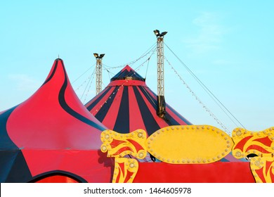 A fragment of the circus design, a dome on the sky background. A circus on wheels. Entertainment for children and adults. Luminous LED signboard, letters of the word circus