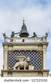 Fragment of Clock Tower with winged lion and two moors striking the bell - early Renaissance (1497) building in Venice, located the north side of Piazza San Marco, Italy, Europe.