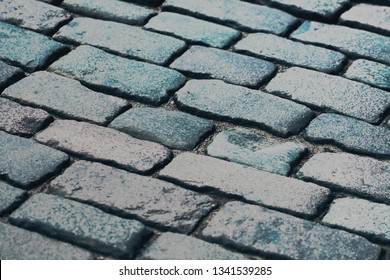 fragment of a cobblestone pavement closeup