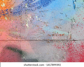 Fragment of colored street abstract art graffiti paintings. texture, background of colorful strokes.