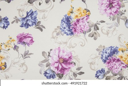 Fragment of colorful retro tapestry textile pattern with floral ornament useful as background. Floral textile or cloth, macro shot. Fabric texture. tissue, textile, cloth, material, woven.