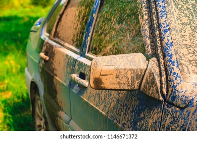 Fragment of dirty car in rural areas close-up