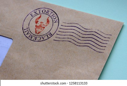 Fragment of an envelope with postal stamp illustrating the concept of blackmail for extortion