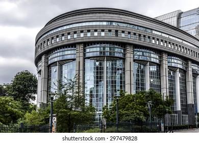 Fragment of European Parliament Buildings, European symbols and flags. Brussels, Belgium.