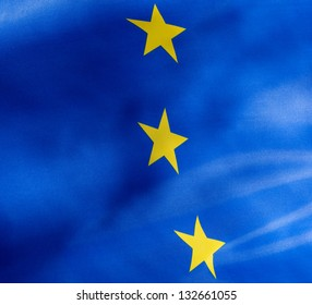 Fragment of a flag of  European Union in the sunshine