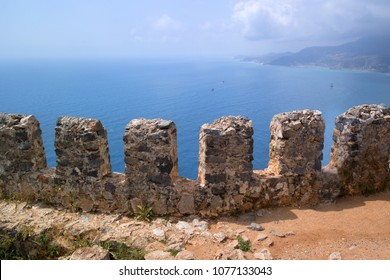 Fragment of the fortress wall overlooking the sea. These are the so-called teeth of the fortress wall. Fortress of Alanya in Turkey.
