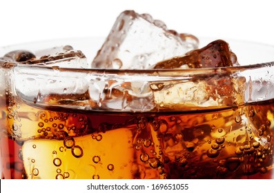 Fragment of glass cola with ice isolated on white background