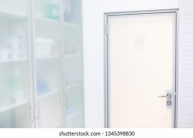 Fragment of a glass door and cabinet. White, frosted glass.