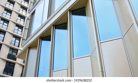 Fragment of glass and metal facade walls. Commercial office buildings. Abstract modern business architecture.