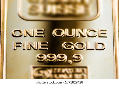 A fragment of a gold bar is one ounce. Pure gold.
