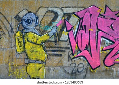 Fragment of graffiti drawings. The old wall decorated with paint stains in the style of street art culture. Scary scuba diver