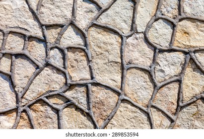 Fragment of a grey stone wall as background