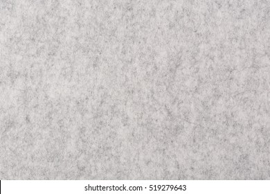Fragment of grey thick felt material. High resolution photo.