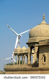 fragment of a Hindu temple on the background of wind turbine shot in Jaisalmer, India