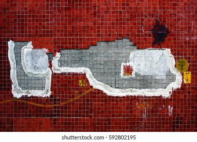 A fragment of a house wall. Fallen tiles have formed a pattern that looks like an image of a helicopter. Russia, Moscow Region, town of Puschino, June 2016.