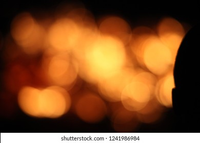 Fragment of human head and ear silhouette on the blurred fire flame abstract art texture background, passion ,energy, mystic, spiritual, listening, meditation concept