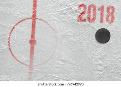 Fragment of ice hockey arena with a puck. Concept, hockey, season 2018