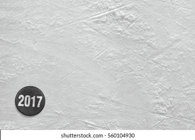 Fragment of ice hockey rink with the puck the new season. Concept, hockey