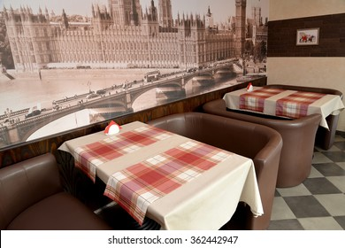 Fragment of an interior of modern cafe in brown tones. Stylization under the London landscape