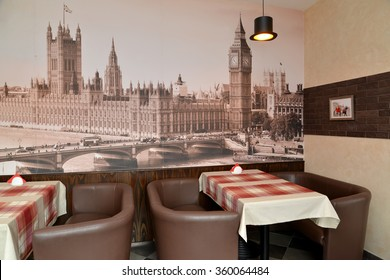 Fragment of an interior of modern cafe with the photo of the Westminster palace on a wall