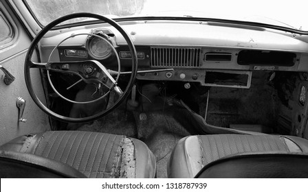 Fragment of interior retro car with speedometer, seats and steering.