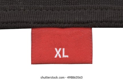 fragment of knitting fabric with red fabric tag