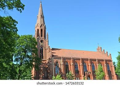 Fragment of Lutheran church of Haynrikhsvalde (1869) against the background of the sky. Slavsk, Kaliningrad region