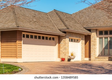 Fragment of a luxury house with a garage door in Vancouver, Canada. Horizontal orientation.