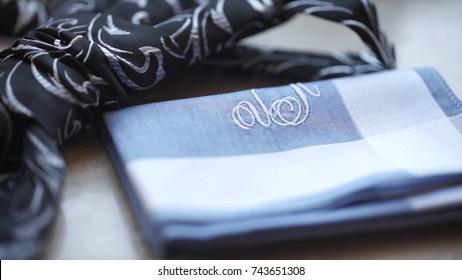 Fragment of a men's shirt with a tie on floor. men's tie and handkerchief. Men's suits dress accessories pocket towel solid color scarf handkerchief
