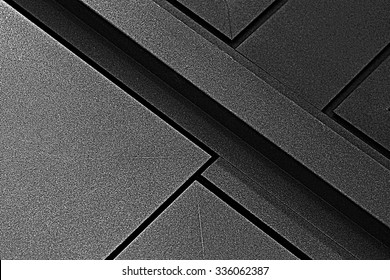 Fragment of metal doors with anti-corrosion protective powder coating. Industrial or technological background. Architectural detail. Abstract geometric black and white composition with strong diagonal