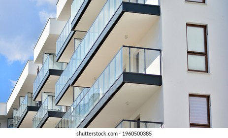 A fragment of modern architecture, walls and glass. Detail of New luxury house and home complex. Part of city real estate property and condo architecture.