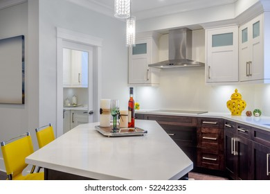 Fragment of a modern, bright, clean, kitchen interior with stainless steel appliances in a luxury house