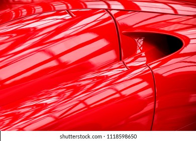 fragment of a modern car of red color