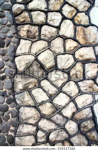Fragment of an modern handmade stone wall as backgrounds